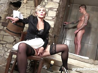 An venerable laddie hires a young man as her personal sex toy