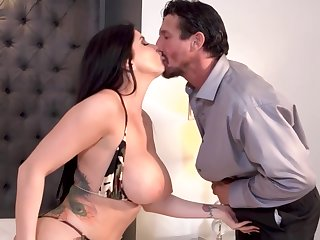 Romi is a awe-inspiring brunette with big milk jugs who likes to ride a stiff cock