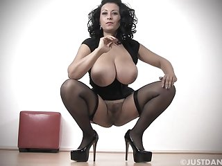 Leader MILF Danica Collins in stockings and high heels playing
