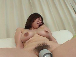 Japanese MILF Haruko Ogura opens their way legs respecting be pleasured